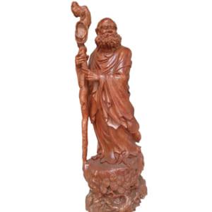 Tượng gỗ Đạt Ma cầm giầy về cố hương