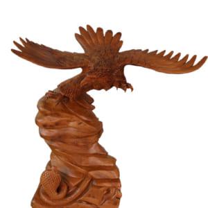 Đại bàng vờn mãng xà gỗ xá xị